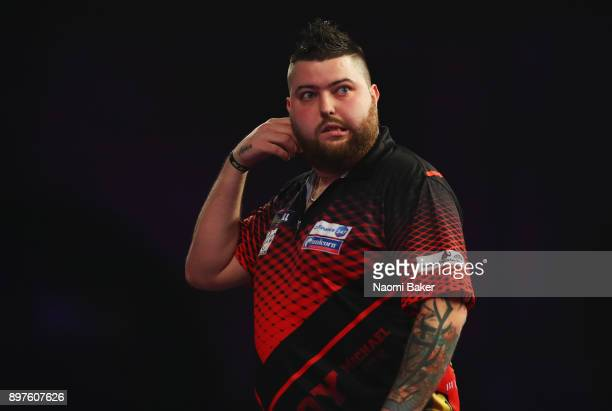 Michael Smith of England in action during the secod round match against Rob Cross of England on day ten of the 2018 William Hill PDC World Darts...