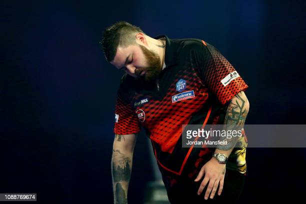 Michael Smith of England looks dejected during the Final match against Michael van Gerwen of the Netherlands during Day 17 of the 2019 William Hill...