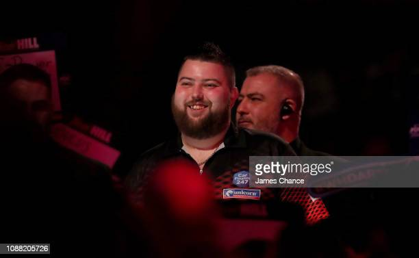 Michael Smith of England makes his way to the stage prior to the 2019 William Hill World Darts Championship SemiFinal match between Nathan Aspinall...