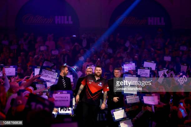 Michael Smith of England prepares to walk to the oche ahead of the Final match against Michael van Gerwen of the Netherlands during Day 17 of the...