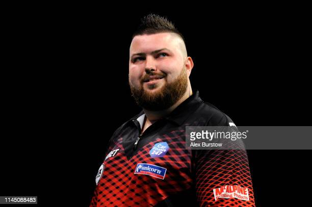 Michael Smith of England reacts during his match against Mensur Suljovic of Austria during the 2019 Unibet Premier League Darts at Arena Birmingham...