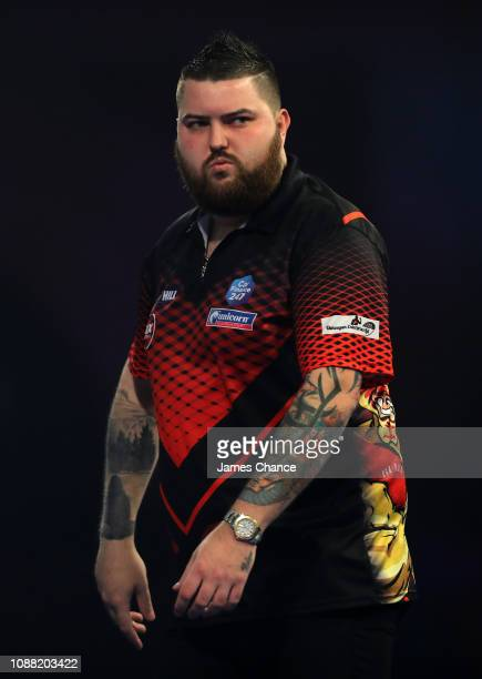 Michael Smith of England reacts during the 2019 William Hill World Darts Championship SemiFinal match between Nathan Aspinall and Michael Smith at...