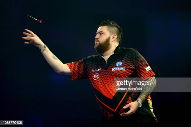 Michael Smith of England throws during the Final match against Michael van Gerwen of the Netherlands during Day 17 of the 2019 William Hill World...