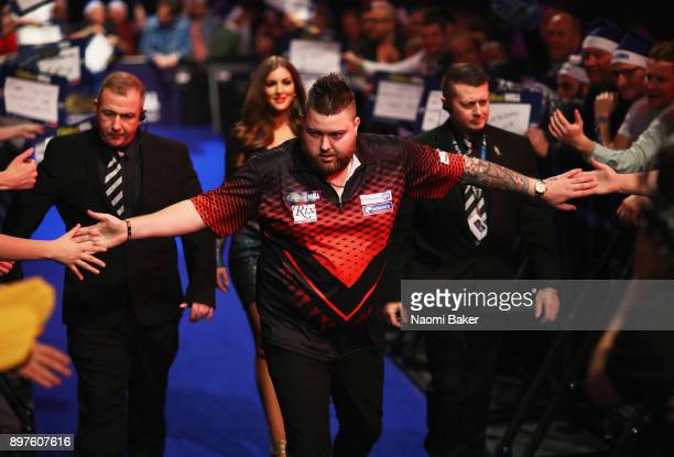 Michael Smith of England walks onto the stage prior to the secod round match against Rob Cross of England on day ten of the 2018 William Hill PDC...