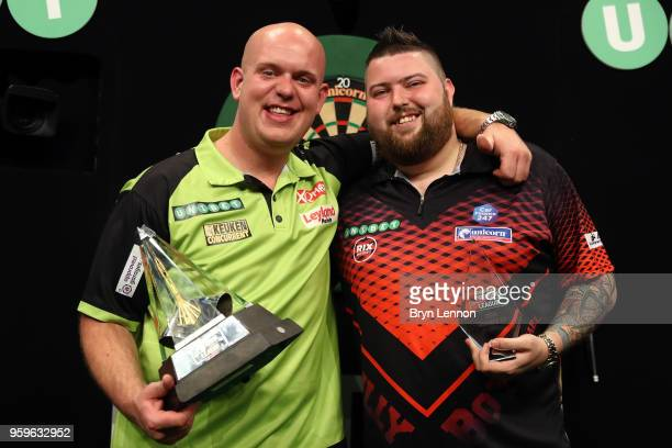 Michael Smith of Great Britain poses with Michael van Gerwen of The Netherlands after the Betway Premier League Darts PlayOffs final at The O2 Arena...