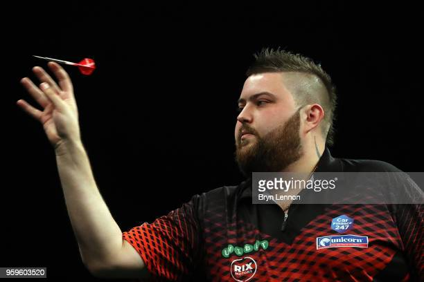 Michael Smith of Great Britain throws against Gary Anderson of Great Britain in their semifinal during the Betway Premier League Darts PlayOffs at...
