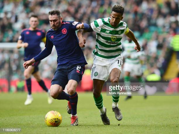 Michael Smith of Hearts battles with Scott Sinclair of Celtic during the Ladbrokes Scottish Premiership match between Celtic and Hearts at Celtic...