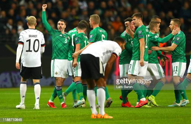 Michael Smith of Northern Ireland celebrates after scoring his team's first goal with teammates during the UEFA Euro 2020 Qualifier between Germany...
