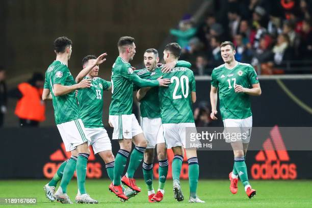 Michael Smith of Northern Ireland celebrates with Craig Cathcart after scoring his team's first goal during the UEFA Euro 2020 Qualifier between...