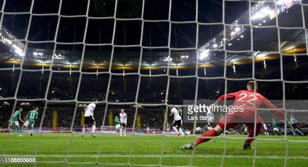 Michael Smith of Northern Ireland scores his teams first goal against goalkeeper Marc Andre ter Stegen of Germany during the UEFA Euro 2020 Qualifier...