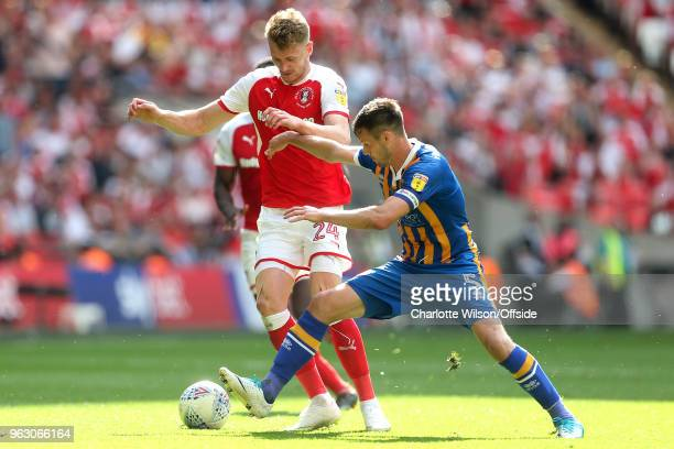 Michael Smith of Rotherham and Shrewsbury captain Mat Sadler battle for the ball during the Sky Bet League One Play Off Semi FinalSecond Leg between...