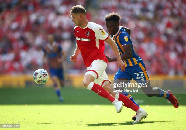 Michael Smith of Rotherham United is challenged by Aristote Nsiala of Shrewsbury Town during the Sky Bet League One Play Off Final between Rotherham...