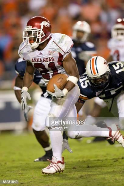 Michael Smith of the Arkansas Razorbacks runs for a touchdown against the Auburn Tigers at JordanHare Stadium on October 11 2008 in Auburn Alabama...