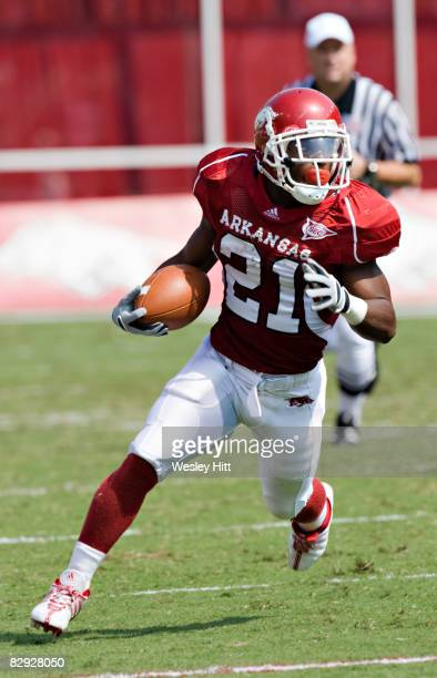 Michael Smith of the Arkansas Razorbacks runs with the ball against the Alabama Crimson Tide at Donald W Reynolds Stadium on September 20 2008 in...