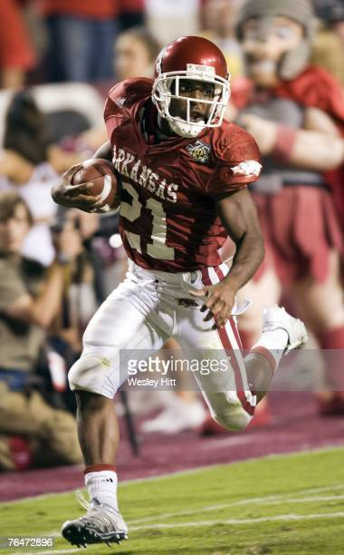 Michael Smith of the Arkansas Razorbacks runs with the ball during a game against the Troy Trojans at Donald W Reynolds Stadium September 1 2007 in...