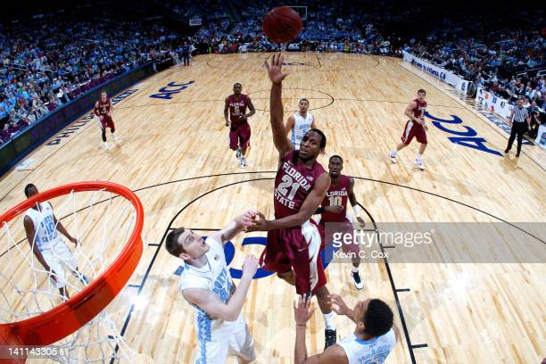 Michael Snaer of the Florida State Seminoles shoots over Tyler Zeller and James Michael McAdoo of the North Carolina Tar Heels during the Final Game...