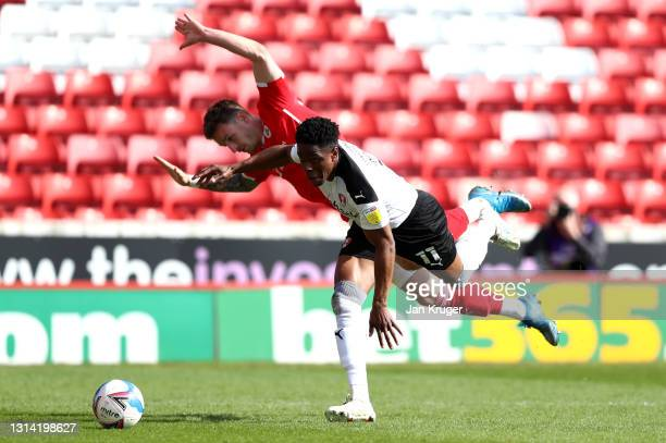 Michael Sollbauer of Barnsley battles for possession with Chiedozie Ogbene of Rotherham United during the Sky Bet Championship match between Barnsley...