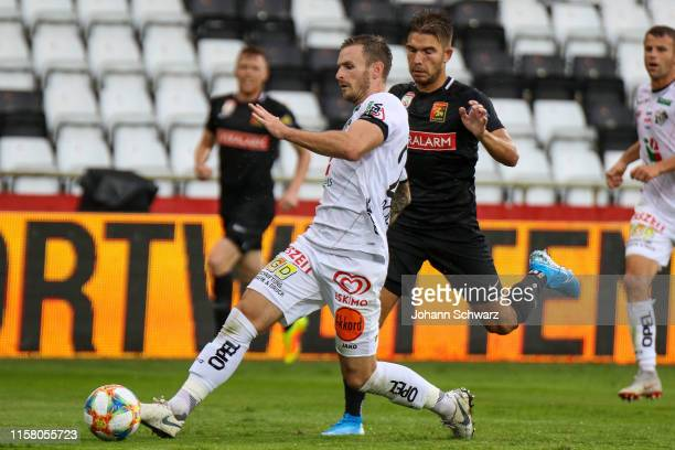 Michael Sollbauer of Wolfsberg and Patrick Schmidt of Admira compete for the ball during tipico Bundesliga match between FC Flyeralarm Admira v RZ...