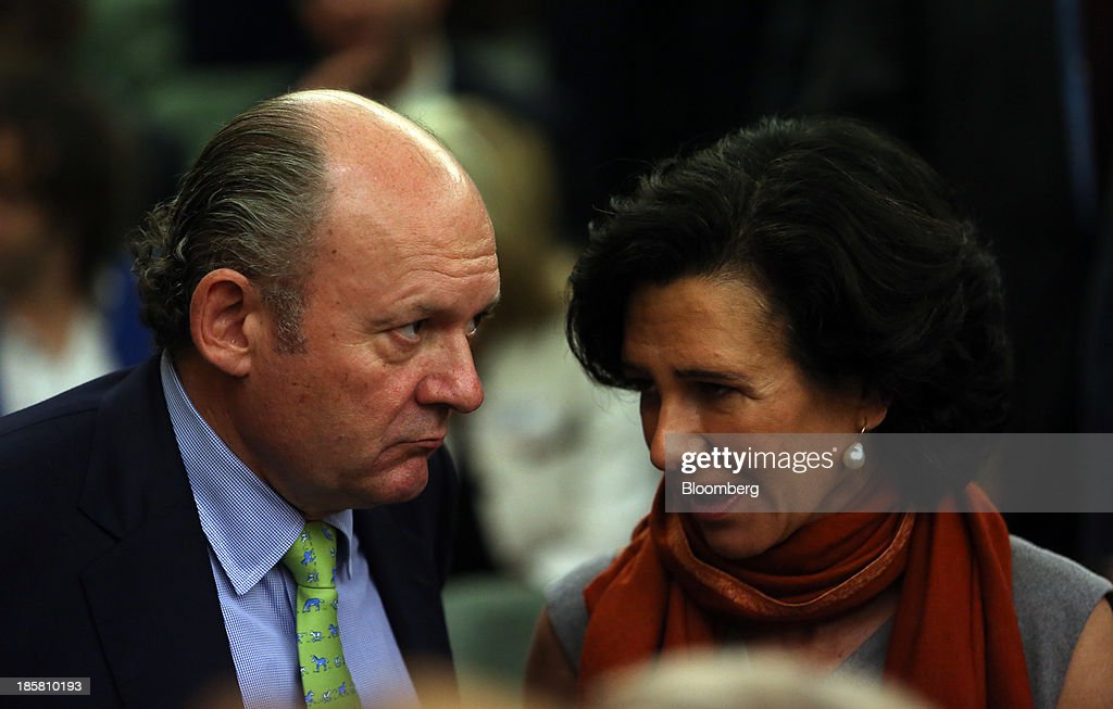 Michael Spencer, chief executive officer of ICAP Plc., left, speaks with Ana Botin, chief executive officer of Santander U.K. Plc., during an event to mark the 125th anniversary of the Financial Times in London, U.K., on Thursday, Oct. 24, 2013. U.K. economic growth accelerated to its fastest pace in more than three years in the third quarter as the recovery continued across all main industries. Photographer: Chris Ratcliffe/Bloomberg via Getty Images