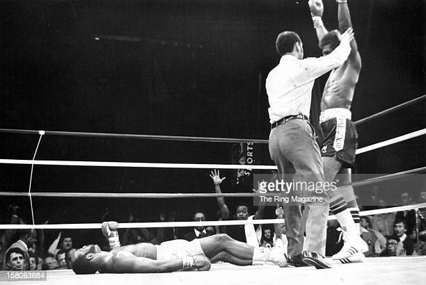 Michael Spinks celebrates knocking down Marvin Johnson during the fight at the Resorts Internationalon March 281981 in Atlantic City New Jersey...