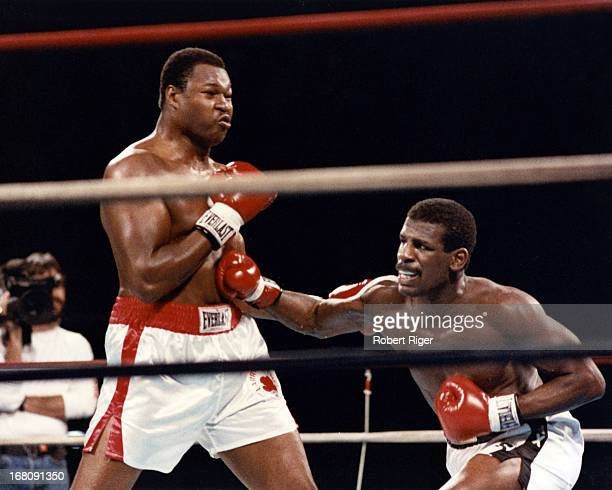 Michael Spinks lands a body blow on Larry Holmes during their IBF Heavyweight Title fight on September 21 1985 at the Riviera Hotel and Casino in Las...