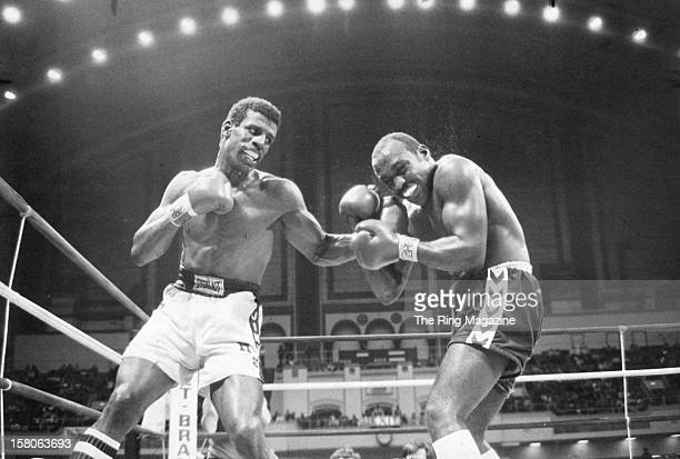 Michael Spinks lands a left punch against Dwight Muhammad Qawi during the fight at the Convention Center on March 181983 in Atlantic City New Jersey...