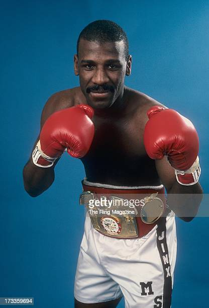 Michael Spinks pose for a portrait with his belt