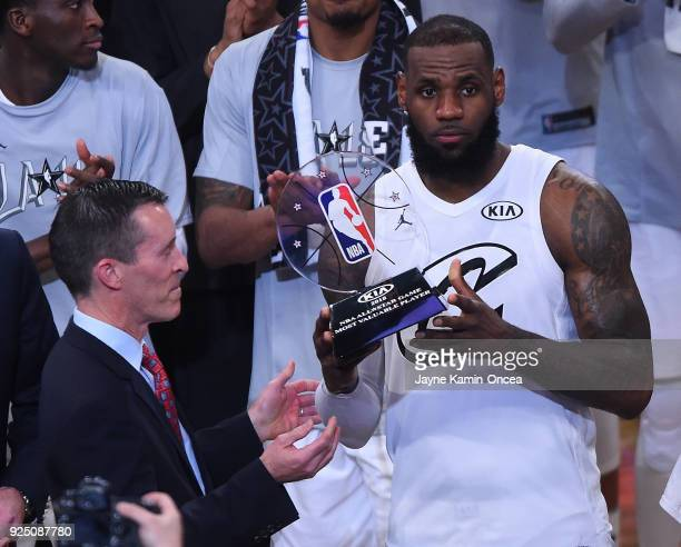 Michael Sprague COO of Kia Motors America presents LeBron James the MVP after the NBA AllStar Game 2018 at Staples Center on February 18 2018 in Los...