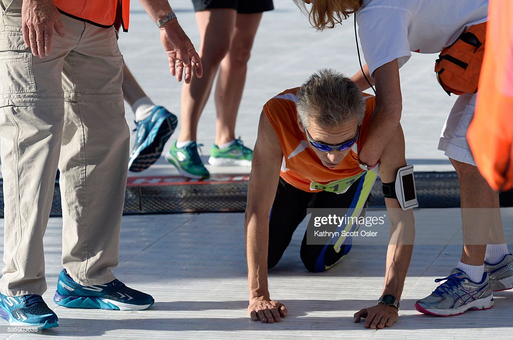 Michael Sprenger of Boulder collapses just before crossing the finish line but still makes it by crawling across. The 38th BolderBOULDER takes place along Boulder's streets with the finish line of the 10k race at Folsom Field on the University of Colorado campus on Monday, May 30, 2016.