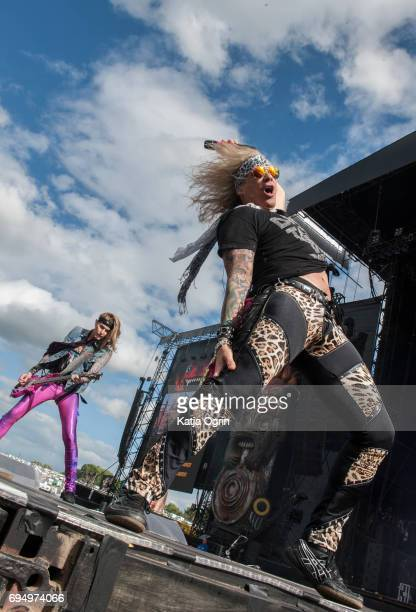 Michael Starr and Lexxi Foxx of Steel Panther performing live on Day 3 of Download Festival at Donington Park on June 11 2017 in Castle Donington UK