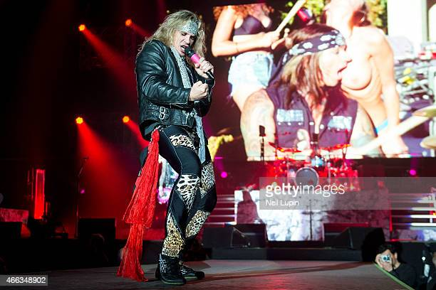 Michael Starr of Steel Panther performs on stage at Wembley Arena on March 14 2015 in London United Kingdom
