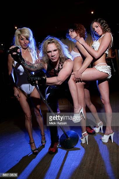 Michael Starr of Steel Panther poses with models at the Canal Room on April 1st 2009 in New York