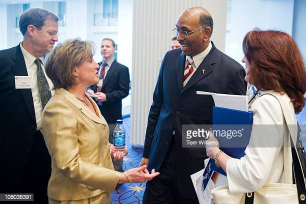 Michael Steele chairman of the Republican National Committee talks wth Ann Wagner candidate for RNC chairman before the RNC's 2011 Winter Meeting...