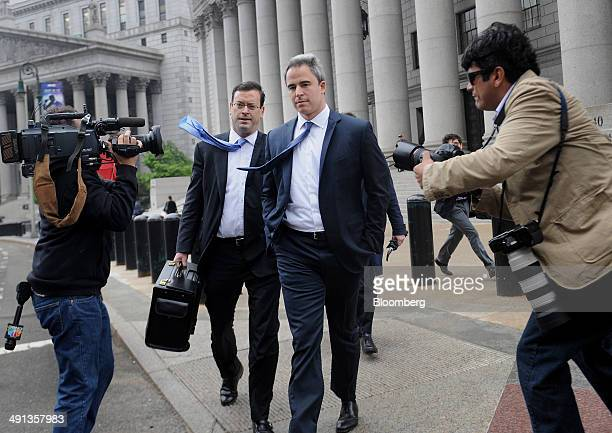 Michael Steinberg a former fund manager with SAC Capital Advisors LP center and attorney Barry Berke left exit federal court following a sentencing...