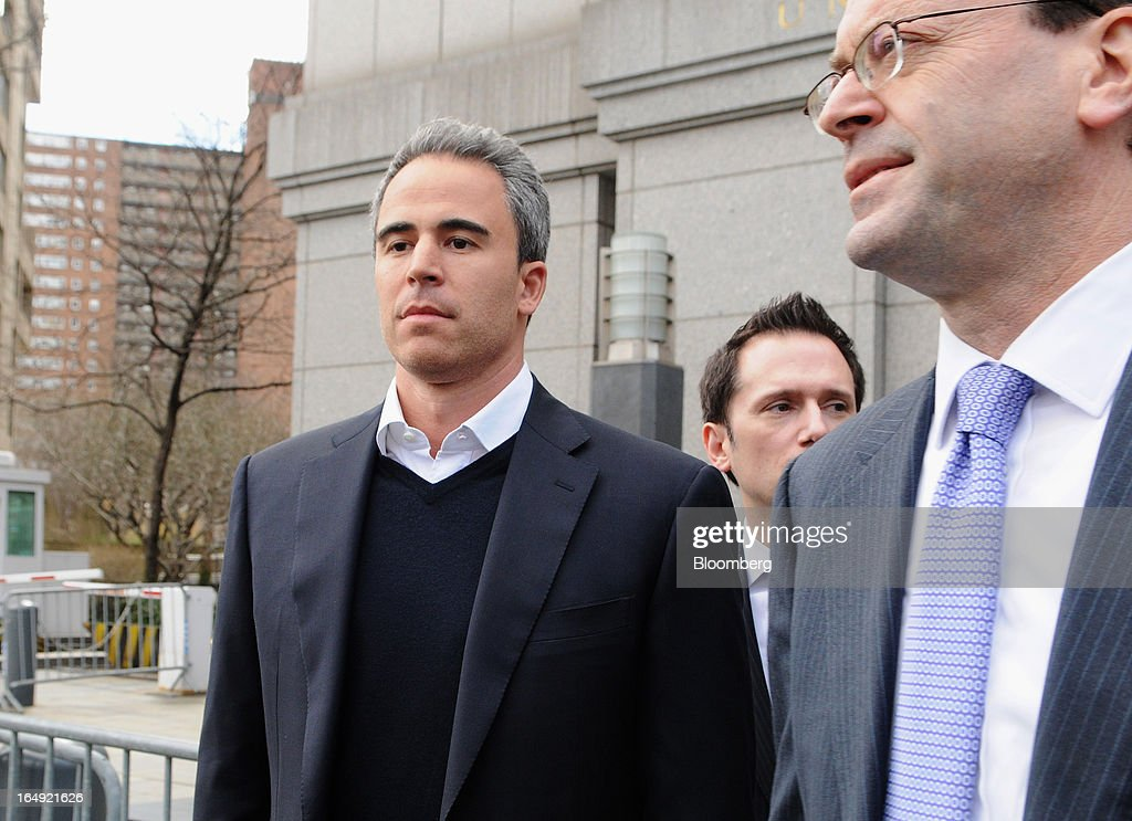 Michael Steinberg, SAC Capital Advisors LP fund manager, who worked at SAC's Sigma Capital Management unit, left, exits federal court in New York, U.S., on Friday, March 29, 2013. Steinberg was indicted by a federal grand jury on five counts of conspiracy and securities fraud as the U.S. government's wide ranging probe of insider trading at the $15 billion firm got one step closer to founder Steven A. Cohen. Photographer: Jonathan Fickies/Bloomberg via Getty Images