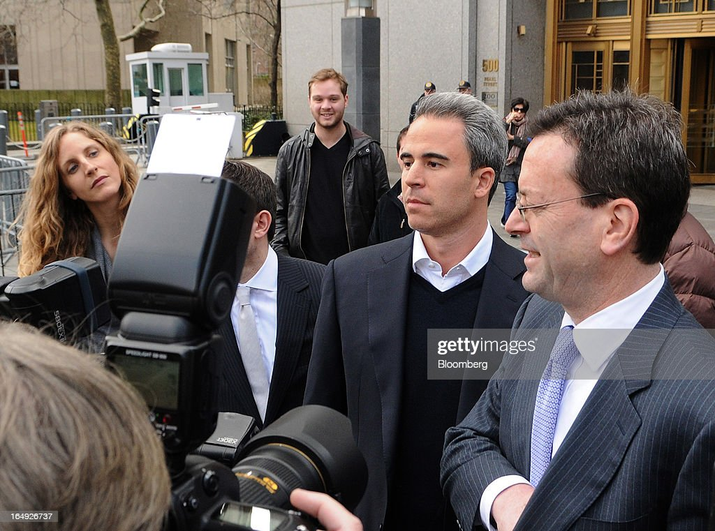 Michael Steinberg, SAC Capital Advisors LP fund manager, who worked at SAC's Sigma Capital Management unit, second right, is photographed by members of the media as he exits federal court in New York, U.S., on Friday, March 29, 2013. Steinberg was indicted by a federal grand jury on five counts of conspiracy and securities fraud as the U.S. government's wide ranging probe of insider trading at the $15 billion firm got one step closer to founder Steven A. Cohen. Photographer: Jonathan Fickies/Bloomberg via Getty Images
