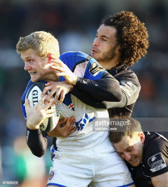 Michael Stephenson of Bath is tackled by Tane Tu'ipulotu and Jimmy Gopperth of Newcastle during the Guinness Premiership match between Newcastle...