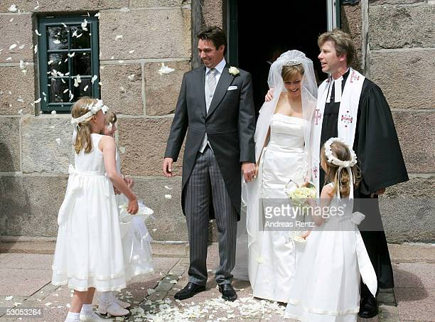 Michael Stich and his wife Alexandra Stich maiden name Rikowski and Pastor Rainer Chunnow at the Sankt Severin church on June 11 2005 at Sylt in...
