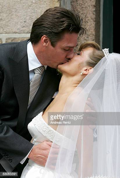 Michael Stich and his wife Alexandra Stich maiden name Rikowski kiss at the Sankt Severin church on June 11 2005 at Sylt in Germany Michael Stich and...