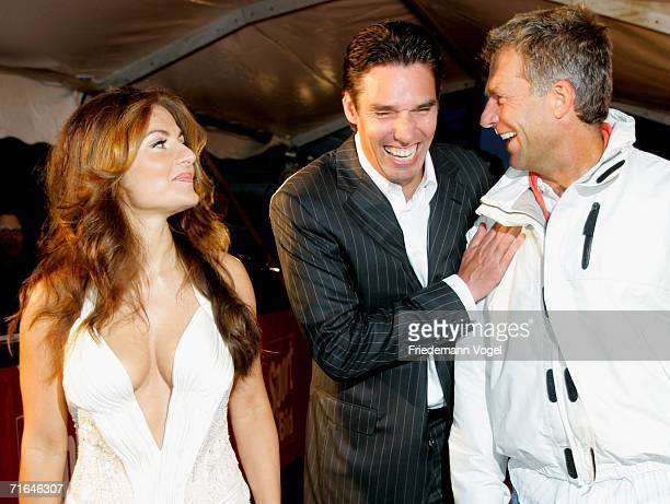 Michael Stich his wife Alexandra and Christian Danner pose for the media before the ceremony of the Sport Bild Awards 2006 on August 14 2006 in...