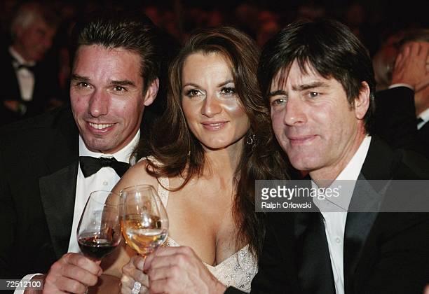 Michael Stich his wife Alexandra and Joachim Loew coach of the German national soccer team attend the Deutscher Sportpresseball on November 11 2006...