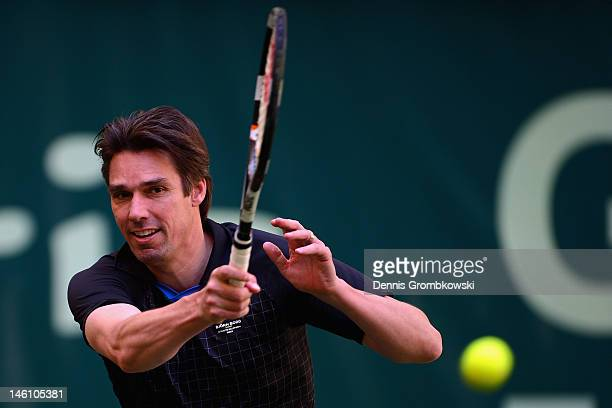 Michael Stich of Germany plays a forehand in his match with Martina Navratilova of USA against Stefan Edberg of Sweden and Anastasia Myskina of...
