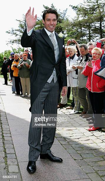 Michael Stich poses for a photograph at the Sankt Severin church on June 11 2005 at Sylt in Germany Michael Stich and Alexandra Rikowski celebrates...