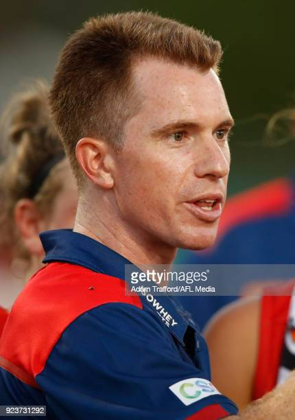 Michael Stinear Senior Coach of the Demons addresses his players during the 2018 AFLW Round 04 match between the Melbourne Demons and the Collingwood...