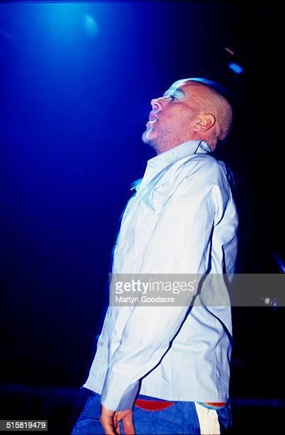 Michael Stipe of REM performs on stage at Glastonbury Festival United Kingdom 1999