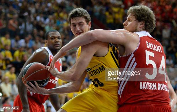 Michael Stockton of Ludwigsburg is challenged by John Bryant of Muenchen during the Beko BBL Playoffs semifinal match between MHP RIESEN Ludwigsburg...