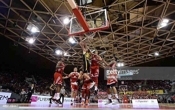 Michael Stockton of Ludwigsburg jumps to score against Nihad Djedovic of Muenchen during game one of the 2014 Beko BBL Playoffs semifinals between FC...