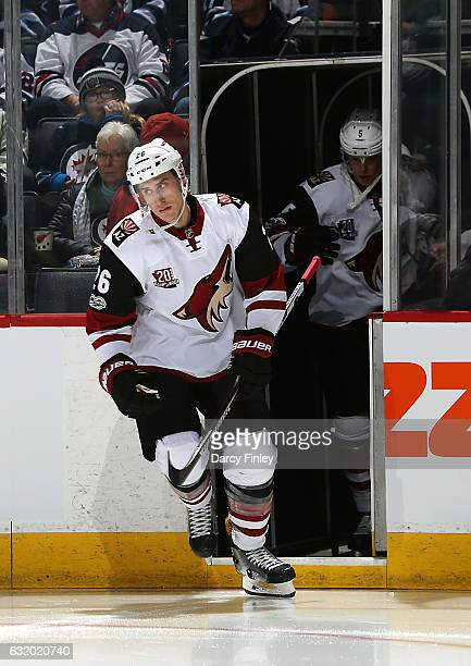 Michael Stone of the Arizona Coyotes hits the ice prior to puck drop against the Winnipeg Jets at the MTS Centre on January 18 2017 in Winnipeg...