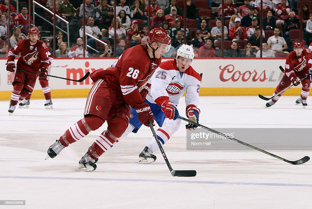 Michael Stone #26 of the Arizona Coyotes skates with the puck as Jacob De La Rose #25 of the Montreal Canadiens defends during the third period at Gila River Arena on March 7, 2015 in Glendale, Arizona.