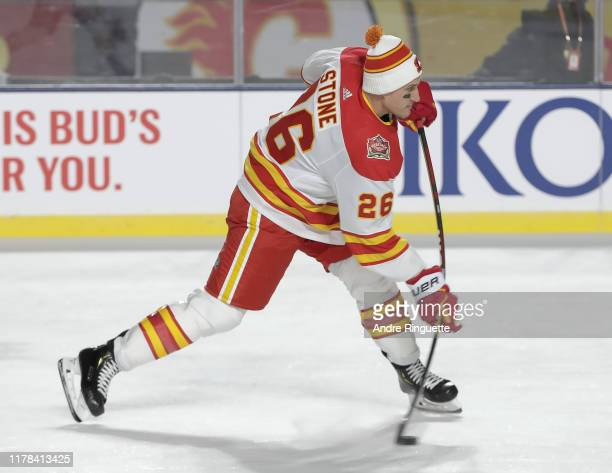 Michael Stone of the Calgary Flames fires a shot during warmup before taking on the Winnipeg Jets during the 2019 Tim Hortons NHL Heritage Classic at...